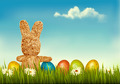 Retro holiday Easter background with straw rabbit and colorful eggs - PhotoDune Item for Sale