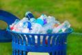 Trash bin full of beverage empty bottles - PhotoDune Item for Sale