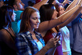 woman with smartphone texting message at concert - PhotoDune Item for Sale