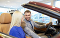 happy couple buying car in auto show or salon - PhotoDune Item for Sale