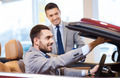 happy man with car dealer in auto show or salon - PhotoDune Item for Sale