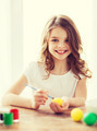 smiling little girl coloring eggs for easter - PhotoDune Item for Sale