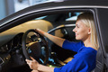 happy woman inside car in auto show or salon - PhotoDune Item for Sale