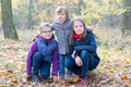 Three sisters in the autumnal forest smiling - PhotoDune Item for Sale