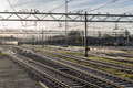 Railway tracks in morning sun at the Dutch station of The Hague - PhotoDune Item for Sale