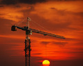 Construction Crane Hoisting the Sun - PhotoDune Item for Sale