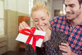 Young man surprising his sweetheart with a gift - PhotoDune Item for Sale