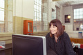 Smiling businesswoman working alone - PhotoDune Item for Sale