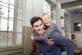 Playful loving couple enjoying a piggy back ride - PhotoDune Item for Sale