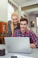 Happy affectionate couple sharing a laptop - PhotoDune Item for Sale