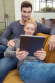 Affectionate couple relaxing with a tablet-pc - PhotoDune Item for Sale