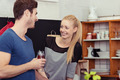 Happy Young Lovers Talking at the Kitchen - PhotoDune Item for Sale