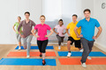 Group Of People Exercising On Mat - PhotoDune Item for Sale