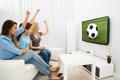 Three Women Watching Football Match - PhotoDune Item for Sale