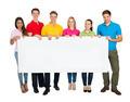 Multiethnic Group Of Friends Showing Blank Billboard - PhotoDune Item for Sale