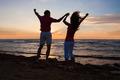 Couple Enjoying Ocean View At Beach During Sunset - PhotoDune Item for Sale
