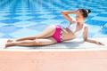 Woman In Swimwear Relaxing At Poolside - PhotoDune Item for Sale