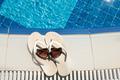 Flip Flops And Sunglasses Beside Swimming Pool - PhotoDune Item for Sale