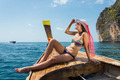 young girl in bikini sitting on boat - PhotoDune Item for Sale