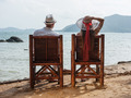 man and a girl sitting on the beach - PhotoDune Item for Sale