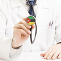 Doctor holding stethoscope with flag series - Mozambique - PhotoDune Item for Sale