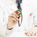 Doctor holding stethoscope with flag series - Guyana - PhotoDune Item for Sale