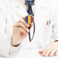 Doctor holding stethoscope with flag series - Romania - PhotoDune Item for Sale