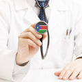 Doctor holding stethoscope with flag series - South Sudan - PhotoDune Item for Sale