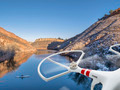 drone flying over lake with canoe - PhotoDune Item for Sale