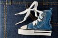 tiny blue shoe on denim background - PhotoDune Item for Sale