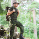 young soldier with backpack in forest - PhotoDune Item for Sale