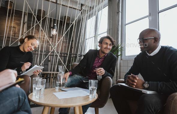 Executives having a meeting indoors