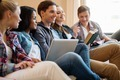Group of multi ethnic young students preparing for exams in home interior - PhotoDune Item for Sale