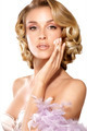 Beautiful elegant model applying a cream treatment on face - PhotoDune Item for Sale