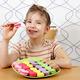 beautiful little girl eat macaroons - PhotoDune Item for Sale
