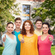 group of smiling teenagers over campus background - PhotoDune Item for Sale