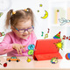 Kid with tablet computer in glasses. Early education. - PhotoDune Item for Sale