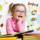 Funny smart kid in glasses reading book in kindergarten - PhotoDune Item for Sale