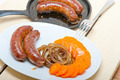 beef sausages cooked on iron skillet - PhotoDune Item for Sale