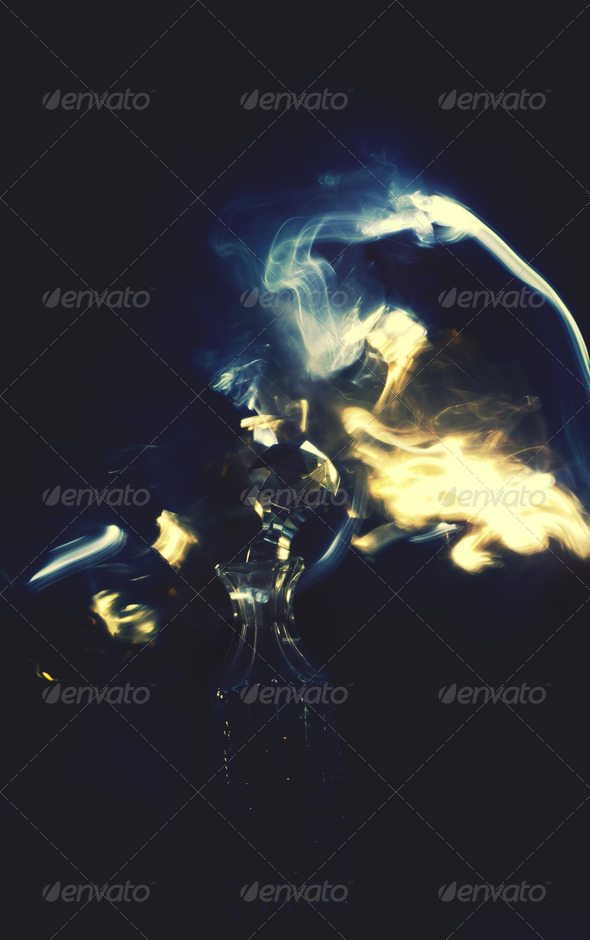 Magic Bottle With Surrounding Flames  - Stock Photo - Images