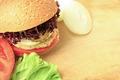 Vegan sea burger closeup on wooden surface - PhotoDune Item for Sale