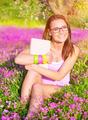 Beautiful student girl on flower field - PhotoDune Item for Sale