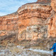 hiker in sandstone canyon - PhotoDune Item for Sale