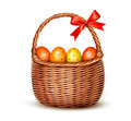 Basket with Easter eggs and a red bow.  - PhotoDune Item for Sale