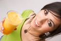 Attractive Woman Intimate Portrait Drinking Orange Fruit Smoothie - PhotoDune Item for Sale
