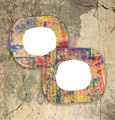 Two blank colorful painted cardboard frames on grunge wall - PhotoDune Item for Sale