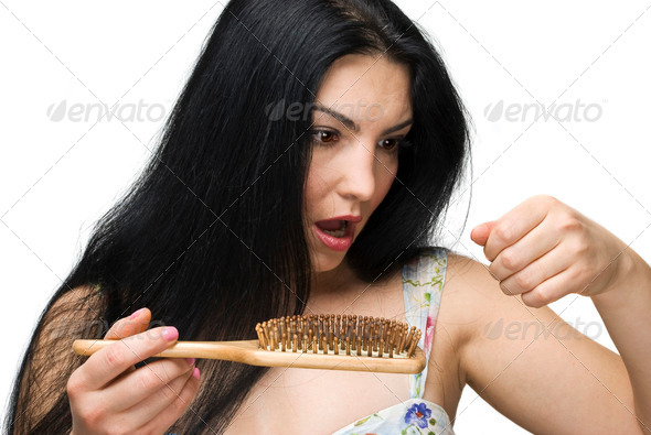 PhotoDune Woman losing hair on hairbrush 1074454