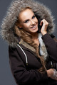 Happy Woman in Jacket with Furry Hood - PhotoDune Item for Sale