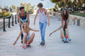 group of kids on skateboards having summer fun - PhotoDune Item for Sale