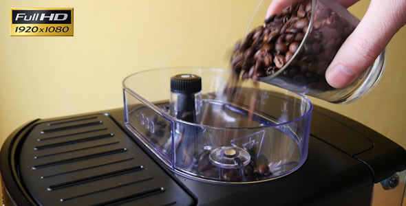 Adding of Roasted Coffee Beans to the Coffee Machi